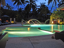 Nighttime pool. A pool in Thailand at night Royalty Free Stock Images