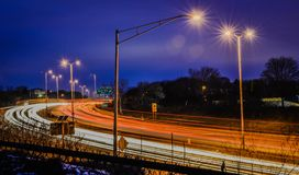 Nighttime rush-hour traffic in Milwaukee Wisconsin. Extended exposure night time traffic scene with streak lights Stock Images