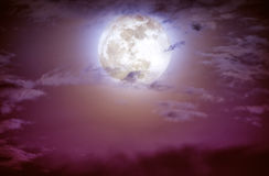 Nighttime sky with clouds and bright full moon. Stock Photo
