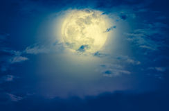 Nighttime sky with clouds and bright full moon. Cross process an Royalty Free Stock Photos