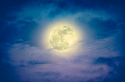 Nighttime sky with clouds and bright full moon. Cross process an Stock Image