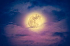 Nighttime sky with clouds and bright full moon. Vintage effect t. Attractive photo of a nighttime sky with clouds and bright full moon. Nightly sky with Stock Photography