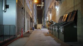 Static night establishing shot of alleyway in Austin city. A nighttime static background plate of an alley in a large city's downtown district. Day/night stock video footage