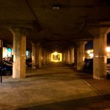 Nighttime under the train station Royalty Free Stock Images