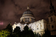 Nighttime view of St Paul's Cathedral with a cloudy sky central Stock Images