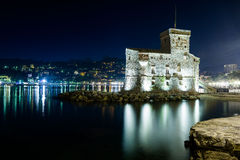 Nightview on the castle on the sea Royalty Free Stock Images