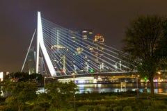 Nightview of Erasmus Bridge reflected in Nieuwe Maas river in Rotterdam, Netherlands Stock Photo