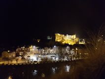 Nightview La Roche en Ardenne. Overview of La Roche by night. Castle lighted up Stock Photo