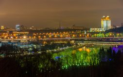 Nightview of Moscow city with Luzhniki stadium, and the Railway bridge over the Moskva river stock images