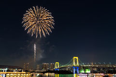 Nightview of Rainbow Bridge and fireworks Stock Image