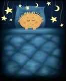 Nighty night. Little boy under dark blue quilt with golden stars around Stock Photos