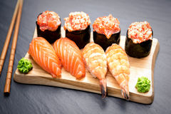 Nigiri and Gunkan Sushi Traditional Japanese Food. Delicious Sushi Nigiri and Gunkan mako with crab and salmon Stock Photos