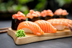 Nigiri and Gunkan Sushi Traditional Japanese Food. Delicious Sushi Nigiri and Gunkan mako with crab and salmon Royalty Free Stock Image