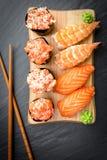 Nigiri and Gunkan Sushi Traditional Japanese Food. Delicious Sushi Nigiri and Gunkan mako with crab and salmon Stock Photo