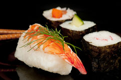 Nigiri and norimaki sushi with prawn. Stock Photography