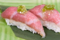 Nigiri of raw beef Kobe beef with green sauce. Macro details royalty free stock photo