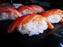 Nigiri Sake salmon sushi close up on black dish royalty free stock photo