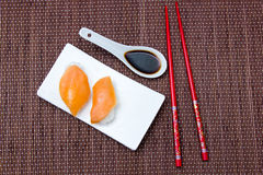 Nigiri with salmon on bamboo seen from above Stock Image