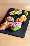 Nigiri sushi mix. On a slate plate stock images