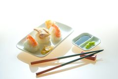 Nigiri sushi. With wasabi paste, soya sauce, pickled ginger and chopsticks stock photos