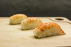 Nigiri-sushi on the board. Three pieces of nigiri-sushi on the board Royalty Free Stock Photography