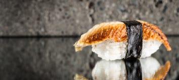 Nigiri sushi with eel. Over concrete background Royalty Free Stock Photo