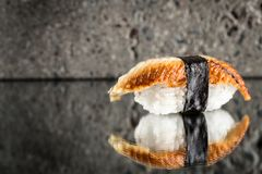 Nigiri sushi with eel. Over concrete background Royalty Free Stock Images