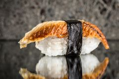 Nigiri sushi with eel. Over concrete background Royalty Free Stock Image