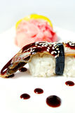 Nigiri sushi with eel, unagi sauce and sesame Royalty Free Stock Photo