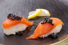Nigiri Sushi with Fresh Salmon and Black Caviar Stock Photo