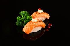 Nigiri sushi. Grilled nigiri sushi on black background stock images
