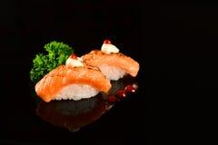 Nigiri sushi. Grilled nigiri sushi on black background stock photo