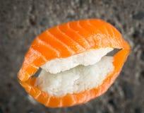 Nigiri sushi with marinated salmon Royalty Free Stock Photos
