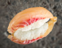 Nigiri sushi with marinated sea bass. Over concrete background stock images