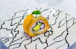 Nigiri or sushi rolls on plate. Delicious japanese sushi rolls with salmon Royalty Free Stock Photography