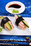 Nigiri sushi with salmon and avocado Stock Photos