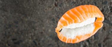 Nigiri sushi with salmon. Over concrete background Stock Image