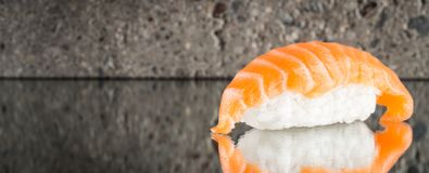 Nigiri sushi with salmon. Over concrete background Stock Images