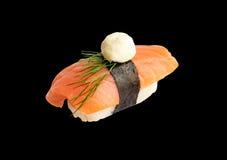 Nigiri Sushi with Salmon and Seaweed Nori on Black Background Royalty Free Stock Photography