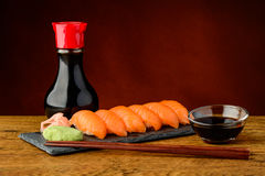 Nigiri sushi with salmon, soy sauce and chopsticks Royalty Free Stock Photography