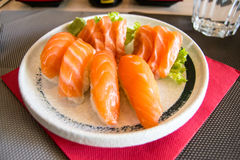 Nigiri sushi with salmon on a white plate Royalty Free Stock Images