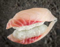 Nigiri sushi with sea bass. Over concrete background royalty free stock images