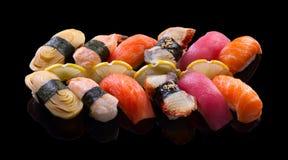 Nigiri sushi set. On black background royalty free stock photography
