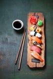 Nigiri sushi set on wooden serving board royalty free stock photography