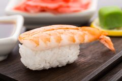 Nigiri sushi with shrimp. On a wooden plate royalty free stock photo