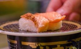 Nigiri Sushi at conveyor belt cafe in Japan. Nigiri Sushi sold at conveyor belt cafe in Japan stock images