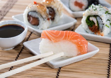 Nigiri Sushi with sticks and Soy Sauce Stock Photo