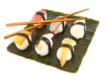 Nigirizushi sushi over nori sheet Stock Images