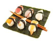 Nigirizushi sushi over nori sheet Royalty Free Stock Image