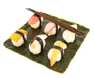 Nigirizushi sushi over nori sheet Royalty Free Stock Photos